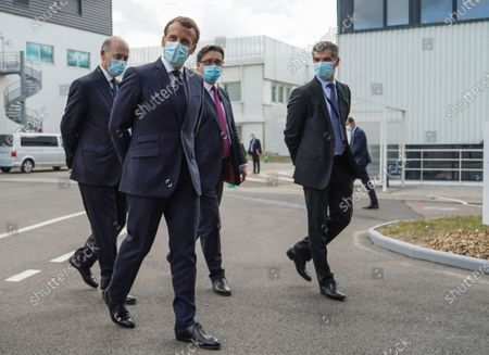 Board Director of Sanofi Serge Weinberg, French President Emmanuel Macron, CEO of Sanofi Paul Hudson, and President of Sanofi France Olivier Bogillot arrive at the French drugmaker's vaccine unit Sanofi Pasteur plant in Marcy-l'Etoile, near Lyon, central France, Tuesday, June 16, 2020.The visit comes after rival pharmaceutical company AstraZeneca this weekend announced a deal to supply 400 million vaccine doses to EU countries, including France.