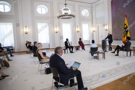 German President Frank-Walter Steinmeier (C) speaks with Gerald Asamoah (first raw L-R), former football player, Gloria Boateng, teacher and education activist, Vanessa Tadala Chabvunga, from Jewish high school Moses Mendelssohn and Daniel Gyamerah division manager of Think-Tanks 'Citizens For Europe' in Berlin while hosting a discussion on racism in Germany at Schloss Bellevue palace, Berlin, Germany, 16 June 2020. German cities have seen their own share of protests against racism and police violence since the death of George Floyd in the USA.