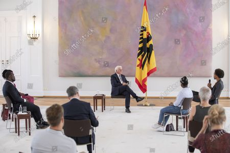 German President Frank-Walter Steinmeier (C) speaks with Gerald Asamoah (L-R first row), former football player,  Gloria Boateng, teacher and education activist, Vanessa Tadala Chabvunga, from Jewish high school Moses Mendelssohn and Daniel Gyamerah division manager of Think-Tanks 'Citizens For Europe' in Berlin while hosting a discussion on racism in Germany at Schloss Bellevue palace, Berlin, Germany, 16 June 2020. German cities have seen their own share of protests against racism and police violence since the death of George Floyd in the USA.