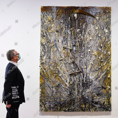 "A visitor, wearing a facemask and carrying a bag with a topical message, views ""Memento Mori"", 2020, by Anselm Kiefer on the opening day of a new exhibition ""Art Basel at Ely House"" taking place at Galerie Thaddaeus Ropac in Mayfair. The commercial gallery has implemented social distancing guidelines for visitors for its reopening after coronavirus pandemic lockdown restrictions were relaxed by the UK government. The exhibition runs 16 June to 31 July 2020."