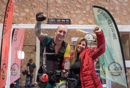 British entrepreneur Ben Miles (L) celebrates with his wife while cycling in Palma de Majorca, Spain, 16 June 2020. Miles, 39, has entered the Guinness World Records after peddling for more than 11 days with only five minute rest every hour.