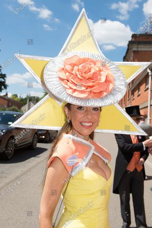 Milliner Tracy Rose wears a striking yellow and orange hat to Royal Ascot