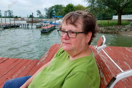 In this August 2017 photo, Associated Press journalists' wife, Mary Lou Gillispie sits for a photo in Marblehead, Ohio. Mary Lou died from cancer in late April