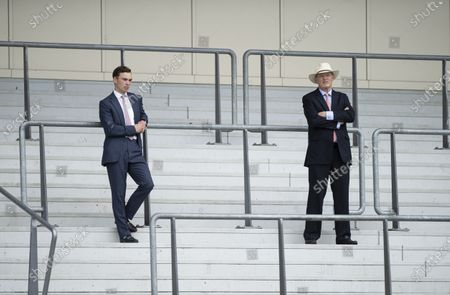 John Gosden (R) and his assistant Thady Gosden watch Lord North win the Group 1 Prince Of Wales's Stakes