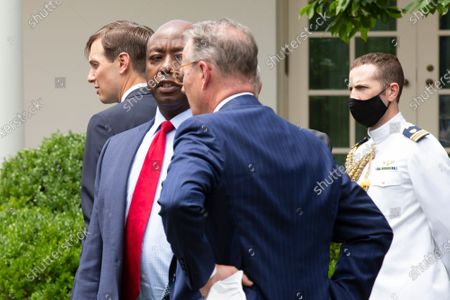 Jared Kushner, Assistant to the President and Senior Advisor, left, and United States Senator Tim Scott (Republican of South Carolina) stand in the Rose Garden following the signing of an Executive Order on Safe Policing for Safe Communities at the White House in Washington D.C., U.S..