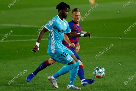 Stock Picture of Legane's Chidozie Awaziem, front, vies for the ball with FC Barcelona's Arthur Melo during the Spanish La Liga soccer match between FC Barcelona and Leganes at the Camp Nou stadium in Spain, Barcelona