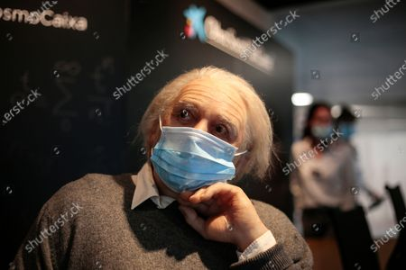Albert Einstein wax figure wearing a face mask at Cosmo Caixa Science Museum. Museums and restaurants have reopened with some restrictions
