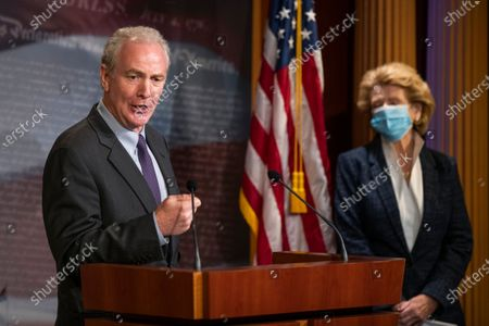 Sen. Chris Van Hollen, D-Md., with Sen. Debbie Stabenow, D-Wis., right, speaks during a news conference on Capitol Hill, in Washington