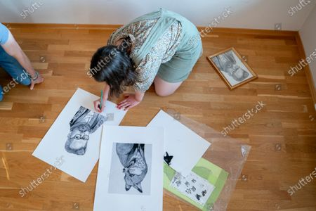 Maud Angelica Behn signs the drawing she has made of her father Ari Behn, during a presentation of an exhibition with Ari Behn's works at Galleri Varden on Jeloya, in Moss, Norway, 16 June 2020.