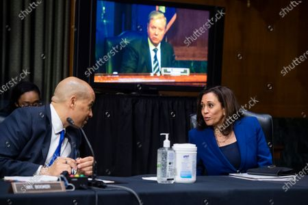 "United States Senator Cory Booker (Democrat of New Jersey), left,, and US Senator Kamala Harris (Democrat of California), right,, attend the US Senate Judiciary Committee hearing titled ""Police Use of Force and Community Relations,"" in the Dirksen Senate Office Building in Washington, D.C.,. United States Senator Lindsey Graham (Republican of South Carolina), Chairman, US Senate Judiciary Committee, center, appears on the monitor."