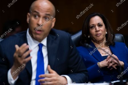 "United States Senator Cory Booker (Democrat of New Jersey), left, and US Senator Kamala Harris (Democrat of California), attend the US Senate Judiciary Committee hearing titled ""Police Use of Force and Community Relations,"" in Dirksen Senate Office Building in Washington, D.C.,."