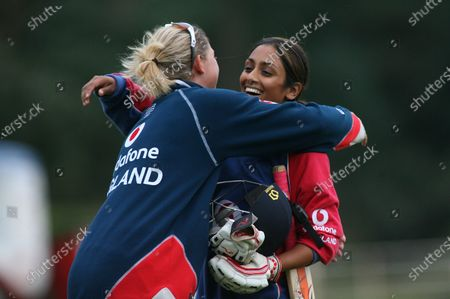 Isa Guha of England (facing) hugs captain Charlotte Edwards at the end of the match