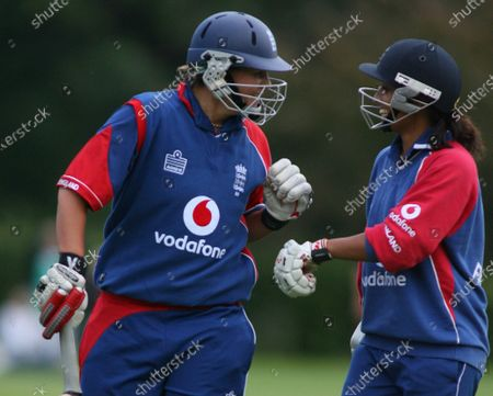 Isa Guha of England (right) with Nicola Shaw at the end of the match