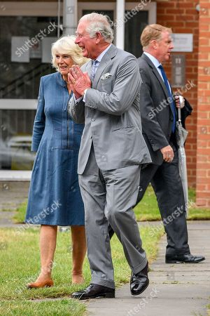 Stock Picture of Prince Charles performs a namaste as he arrives with Camilla Duchess of Cornwall at Gloucestershire Royal Hospital as they meet front line key workers who who have responded to the COVID-19 pandemic during a visit to Gloucestershire Royal Hospital.