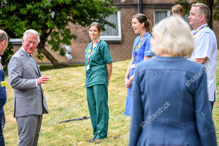 Stock Photo of Prince Charles and Camilla Duchess of Cornwall meet front line key workers who who have responded to the COVID-19 pandemic during a visit to Gloucestershire Royal Hospital.