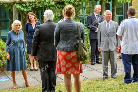 Prince Charles and Camilla Duchess of Cornwall meet front line key workers who who have responded to the COVID-19 pandemic during a visit to Gloucestershire Royal Hospital.