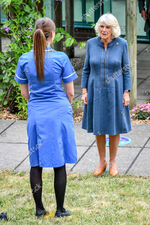Camilla Duchess of Cornwall chats with Critical Care Nurse Lucy Pugh as she meets front line key workers who who have responded to the COVID-19 pandemic during a visit to Gloucestershire Royal Hospital.