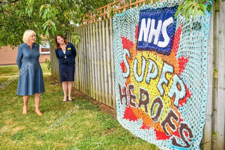 Camilla Duchess of Cornwall is shown a knitted tribute to NHS staff by Chief Executive Officer, Gloucestershire Hospitals NHS Foundation, Deborah Lee, as she meets front line key workers who who have responded to the COVID-19 pandemic during a visit to Gloucestershire Royal Hospital.
