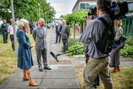 Prince Charles and Camilla Duchess of Cornwall conduct a socially distanced TV interview after meeting front line key workers who who have responded to the COVID-19 pandemic during a visit to Gloucestershire Royal Hospital.