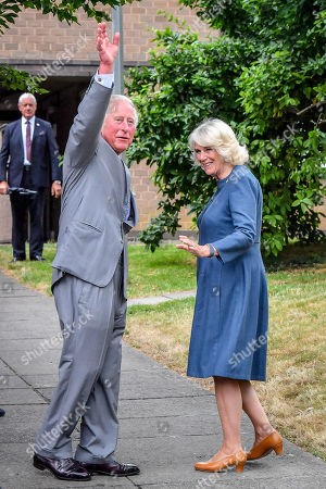 Prince Charles and Camilla Duchess of Cornwall wave goodbye to front line key workers who who have responded to the COVID-19 pandemic during a visit to Gloucestershire Royal Hospital.
