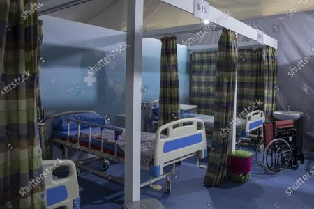 Hospital beds are prepared to receive COVID-19 patients at Ain Shams University Field Hospital in Cairo, Egypt, . The hospital has a capacity of 179 beds including 11 Intensive Care Units, Dr. Ashraf Omar, dean of the medical school said Wednesday in televised comments