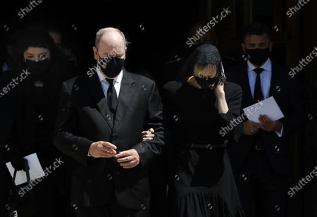 Prince Albert II of Monaco (C), his wife Princess Charlene (R) and Melanie Antoinette de Massy (L) attend the funeral ceremony for Baroness Elizabeth-Ann De Massy at the Cathedral Notre-Dame-Immaculee in Monaco, 17 June 2020. Baroness Elisabeth-Anne de Massy was a first cousin of the reigning Prince Albert II. She died at the age of 73.