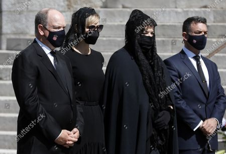 Prince Albert II of Monaco (L), his wife Princess Charlene (2-L), Melanie Antoinette de Massy (2-R) and Jean-Leonard Taubert de Massy (R) attend the funeral ceremony for Baroness Elizabeth-Ann De Massy at the Cathedral Notre-Dame-Immaculee in Monaco, 17 June 2020. Baroness Elisabeth-Anne de Massy was a first cousin of the reigning Prince Albert II. She died at the age of 73.
