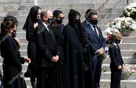 Prince Albert II of Monaco (2-L) and his wife Princess Charlene (C), Princess Stephanie of Monaco (L), Melanie Antoinette de Massy (2-R) and Jean-Leonard Taubert de Massy (R) attend the funeral ceremony for Baroness Elizabeth-Ann De Massy at the Cathedral Notre-Dame-Immaculee in Monaco, 17 June 2020. Baroness Elisabeth-Anne de Massy was a first cousin of the reigning Prince Albert II. She died at the age of 73.