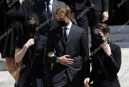 Princess Charlotte of Hanover (L), Pierre Casiraghi (C) and Charlotte Casiraghi (R) attend the funeral ceremony for Baroness Elizabeth-Ann De Massy at the Cathedral Notre-Dame-Immaculee in Monaco, 17 June 2020. Baroness Elisabeth-Anne de Massy was a first cousin of the reigning Prince Albert II. She died at the age of 73.