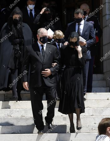 Prince Albert II of Monaco (2-L), his wife Princess Charlene (2-R), Melanie Antoinette de Massy (L) and Jean-Leonard Taubert de Massy (R) attend the funeral ceremony for Baroness Elizabeth-Ann De Massy at the Cathedral Notre-Dame-Immaculee in Monaco, 17 June 2020. Baroness Elisabeth-Anne de Massy was a first cousin of the reigning Prince Albert II. She died at the age of 73.