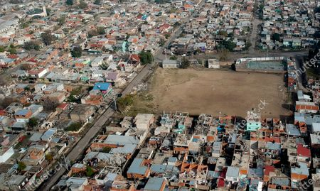 """Soccer field called """"El Potrero,"""" where soccer star Diego Maradona started playing as a kid, is surrounded by homes in the Fiorito slum where he was born in Buenos Aires, Argentina, . Soccer in Argentina has been canceled for more than 80 days now with no restart in sight, cutting off thousands of young players in the poorest neighborhoods from what many felt was their only shot at a better life"""