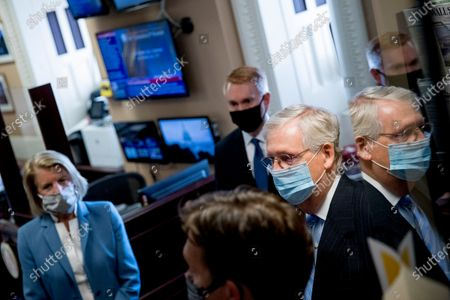 Senate Majority Leader Mitch McConnell of Ky., right, accompanied by Sen. Shelley Moore Capito, R-W.Va., left, and Sen. James Lankford, R-Okla., center, stands with other Republican senators before a news conference to announce a Republican police reform bill on Capitol Hill, in Washington