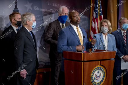 Sen. Tim Scott, R-S.C., center, accompanied by from left, Sen. James Lankford, R-Okla., Senate Majority Leader Mitch McConnell of Ky., Sen. John Cornyn, R-Texas, Sen. Shelley Moore Capito, R-W.Va., and Sen. Lindsey Graham, R-S.C., speaks at a news conference to announce a Republican police reform bill on Capitol Hill, in Washington