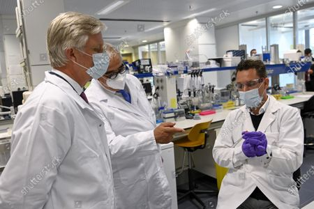 King Philippe - Filip of Belgium (L) and Janssen Pharmaceutica chief scientific officer Paul Stoffels (C) talk to a scientist during a royal visit to the headquarters of Janssen Pharmaceutica in Beerse, Wednesday 17 June 2020.