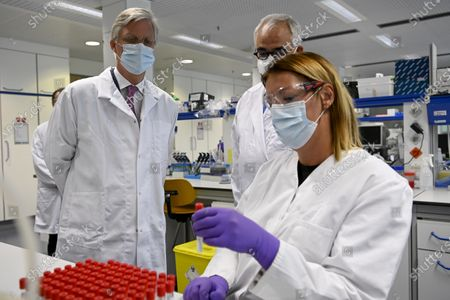 King Philippe - Filip of Belgium (L) and Janssen Pharmaceutica chief scientific officer Paul Stoffels (C) talk to a scientist at work in the laboratroy during a royal visit to the headquarters of Janssen Pharmaceutica in Beerse, Wednesday 17 June 2020.