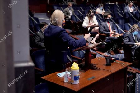 Rep. Debbie Lesko (R-Ariz.) cleans a microphone during a House Judiciary Committee markup of H.R. 7120 the Justice in Policing Act, in Washington, DC, USA, 17 June 2020.