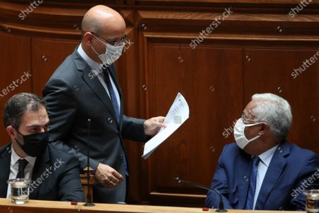 Portuguese new Minister of State and Finance Joao Leao (C), speaks with Portuguese Prime Minister Antonio Costa (R), during the debate and vote on the proposal of the supplementary budget for 2020, in the Assembly of the Republic, in Lisbon, Portugal, 17 June 2020. This is the first remodelling of the XXII Government, and was triggered by the departure of Mario Centeno from the position of Minister of State and Finance, at his request.