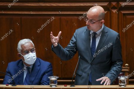 Portuguese new Minister of State and Finance Joao Leao (R), with Portuguese Prime Minister Antonio Costa (L), speaks during the debate and vote on the proposal of the supplementary budget for 2020, in the Assembly of the Republic, in Lisbon, Portugal, 17 June 2020. This is the first remodelling of the XXII Government, and was triggered by the departure of Mario Centeno from the position of Minister of State and Finance, at his request.