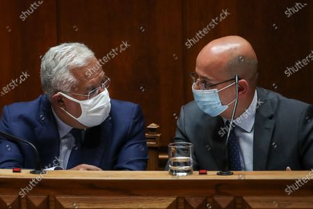 Portuguese Prime Minister Antonio Costa (L), speaks with Portuguese new Minister of State and Finance Joao Leao (R), during the debate and vote on the proposal of the supplementary budget for 2020, in the Assembly of the Republic, in Lisbon, Portugal, 17 June 2020. This is the first remodelling of the XXII Government, and was triggered by the departure of Mario Centeno from the position of Minister of State and Finance, at his request.