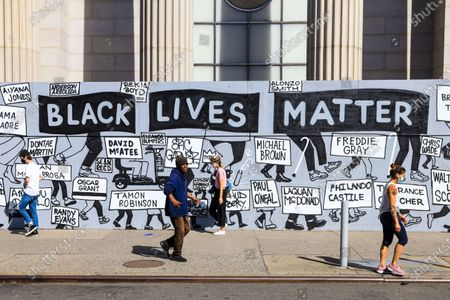 Mural against Racism and with phrases Black Lives Matter in New York in the United States. The protests across the country were motivated after the death of George Floyd on 25 May, after being asphyxiated for 8 minutes and 46 seconds by white police officer Derek Chauvin in Minneapolis, Minnesota.
