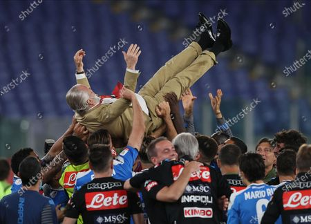 Coppa Italia Final, Napoli versus Juventus; Napoli owner Aurelio De Laurentiis is tossed in the air as Napoli players celebrate their penalty shoot.