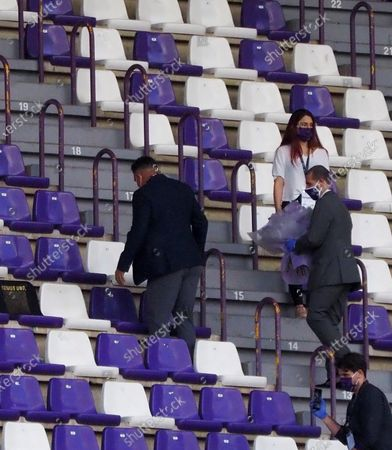 Real Valladolid's President Ronaldo Nazario (L) places flowers on the seats in memory of victims of the coronavirus pandemic, ahead of a Spanish LaLiga soccer match between Real Valladolid and Celta de Vigo at Jose Zorilla stadium in Valladolid, Spain, 17 June 2020.