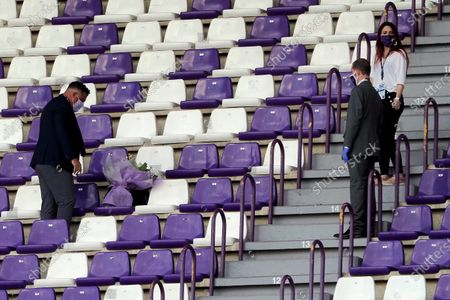 Stock Photo of Real Valladolid's President Ronaldo Nazario (L) places flowers on the seats in memory of victims of the coronavirus pandemic, ahead of a Spanish LaLiga soccer match between Real Valladolid and Celta de Vigo at Jose Zorilla stadium in Valladolid, Spain, 17 June 2020.