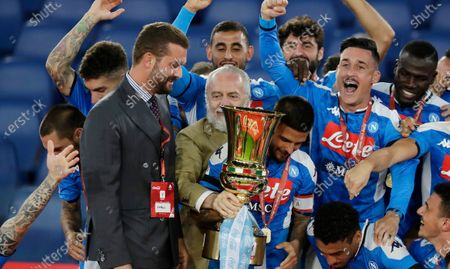 Napoli president Aurelio De Laurentiis holds the Italian Cup trophy at the end of the final match between Napoli and Juventus, at Rome's Olympic Stadium