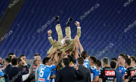 Napoli players lift in the air their president Aurelio De Laurentiis after winning the Italian Cup soccer final match between Napoli and Juventus, at Rome's Olympic Stadium