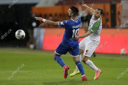 Stock Picture of Hoffenheim's Moanes Dabbur, left, and Augsburg's Stephan Lichtsteiner fight for the ball during the German Bundesliga soccer match FC Augsburg against TSG 1899 Hoffenheim in Augsburg, Germany