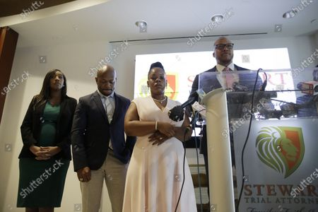 Justin Miller speaks at a news conference, with Chris Stewart, left, Tomika Miller, center, widow of Rayshard Brooks on in Atlanta. Fulton County District Attorney Paul L. Howard Jr. announced former Atlanta Police Officer Garrett Rolfe faces charges including felony murder in the fatal shooting of Brooks on June 12