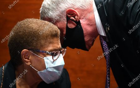 """United States Representative Karen Bass (Democrat of California) talks to United States Representative Ken Buck (Republican of Colorado) during the US House Judiciary Committee markup of H.R. 7120, the """"George Floyd Justice in Policing Act of 2020,"""" on Capitol Hill in Washington, DC. The bill reforms policing in the United States, including provisions to stop police misconduct, and the use of excessive force."""