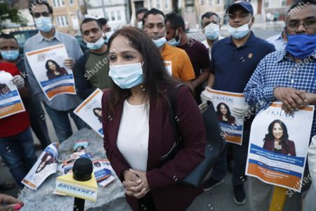 Supporters surround Badrun Khan, center, in New York, as Khan was being interviewed after participating in a debate against U.S. Rep. Alexandria Ocasio-Cortez, D-New York, and Michelle Caruso-Cabrera ahead of New York's June 23 primary
