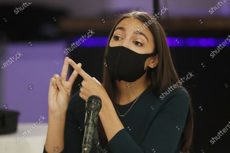 Rep. Alexandria Ocasio-Cortez, D, New York, makes a point during her debate against opponents Michelle Caruso-Cabrera and Badrun Khan ahead of New York's June 23 primary, in New York